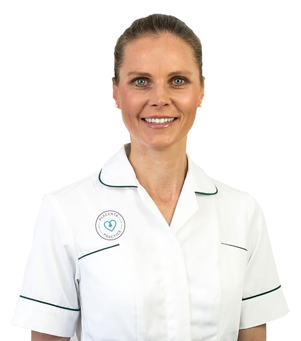 Placenta Practice founder and Placenta Specialist Amanda Denton in a white nurses tunic with company logo